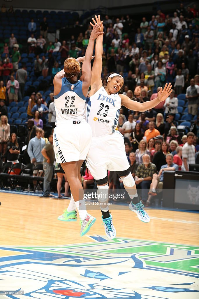 Monica Wright #22 and <a gi-track='captionPersonalityLinkClicked' href=/galleries/search?phrase=Maya+Moore+-+Basketball+Player&family=editorial&specificpeople=4215914 ng-click='$event.stopPropagation()'>Maya Moore</a> #23 of the Minnesota Lynx celebrate after the win against the Los Angeles Sparks during the WNBA game on June 28, 2013 at Target Center in Minneapolis, Minnesota.