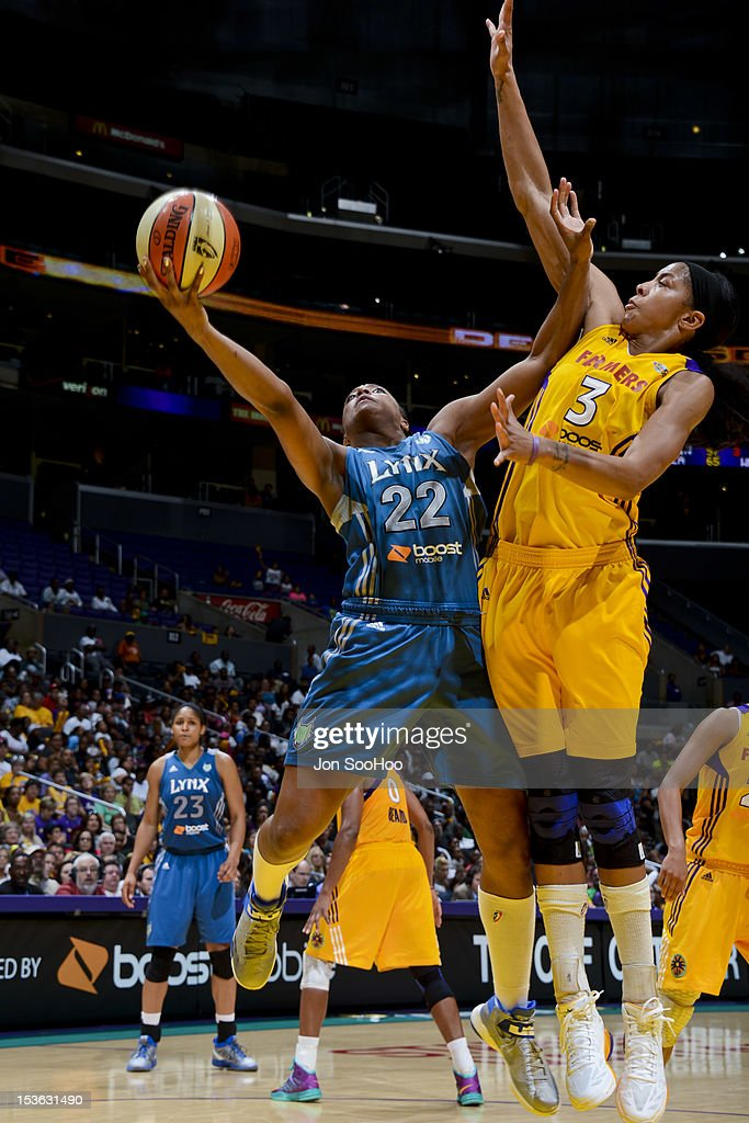 Monica Wright #22 of the Minnesota Lynx attempts a shot against <a gi-track='captionPersonalityLinkClicked' href=/galleries/search?phrase=Candace+Parker&family=editorial&specificpeople=752955 ng-click='$event.stopPropagation()'>Candace Parker</a> #3 of the Los Angeles Sparks in Game Two of the WNBA Western Conference Finals at Staples Center on October 7, 2012 in Los Angeles, California.
