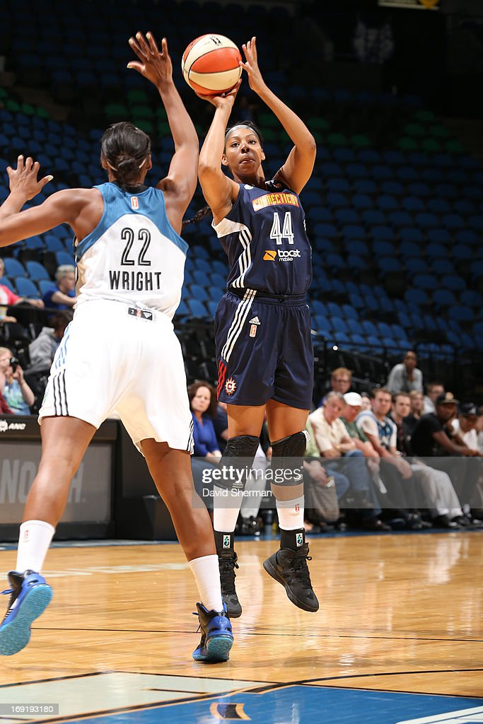 Monica Wright #22 of the Minnesota Lynx defends against Ashley Walker #44 of the Connecticut Sun during the WNBA pre-season game on May 21, 2013 at Target Center in Minneapolis, Minnesota.