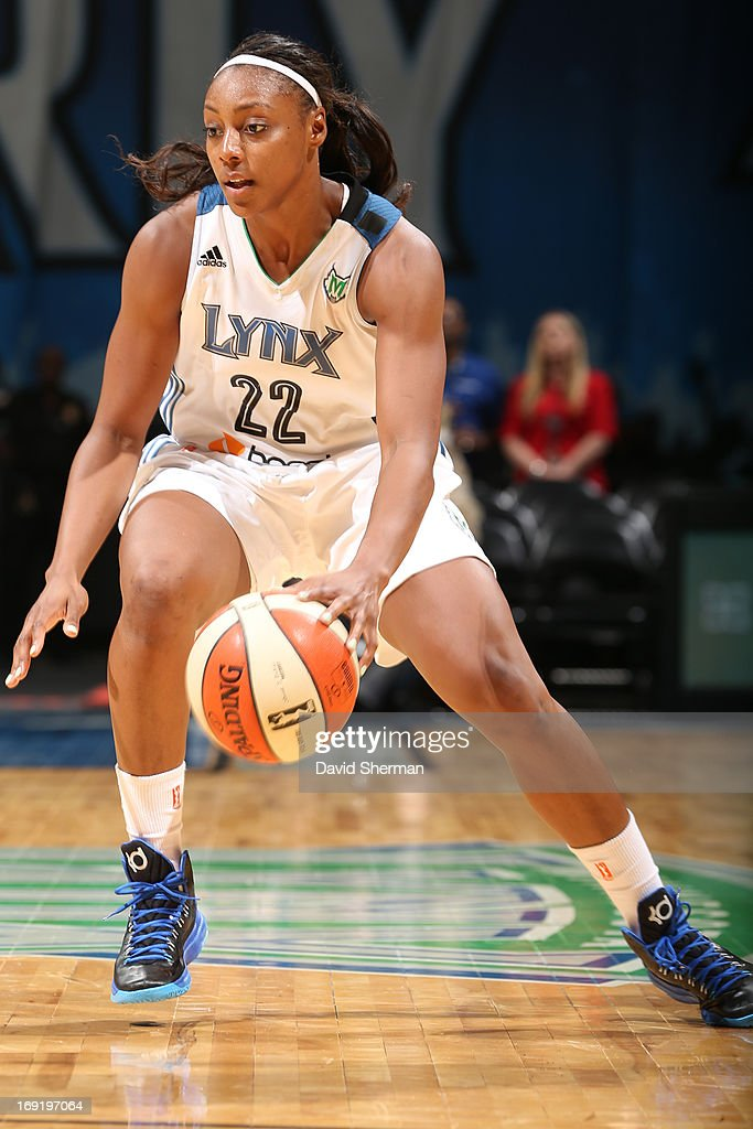 Monica Wright #22 of the Minnesota Lynx dribbles during the WNBA pre-season game against the Connecticut Sun on May 21, 2013 at Target Center in Minneapolis, Minnesota.