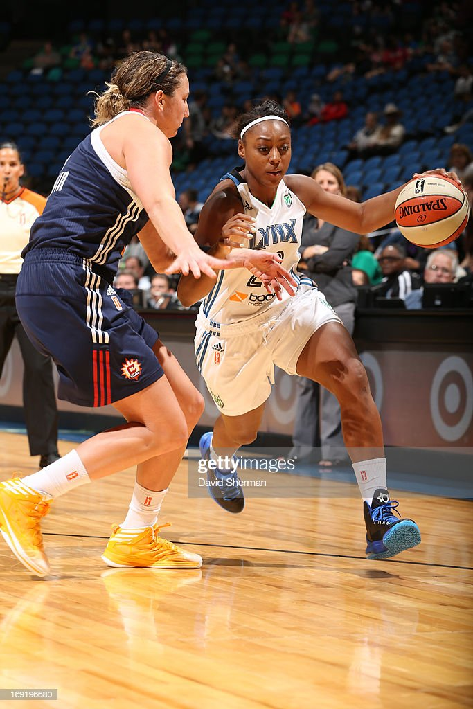Monica Wright #22 of the Minnesota Lynx drives against Kelsey Griffin #5 of the Connecticut Sun during the WNBA pre-season game on May 21, 2013 at Target Center in Minneapolis, Minnesota.