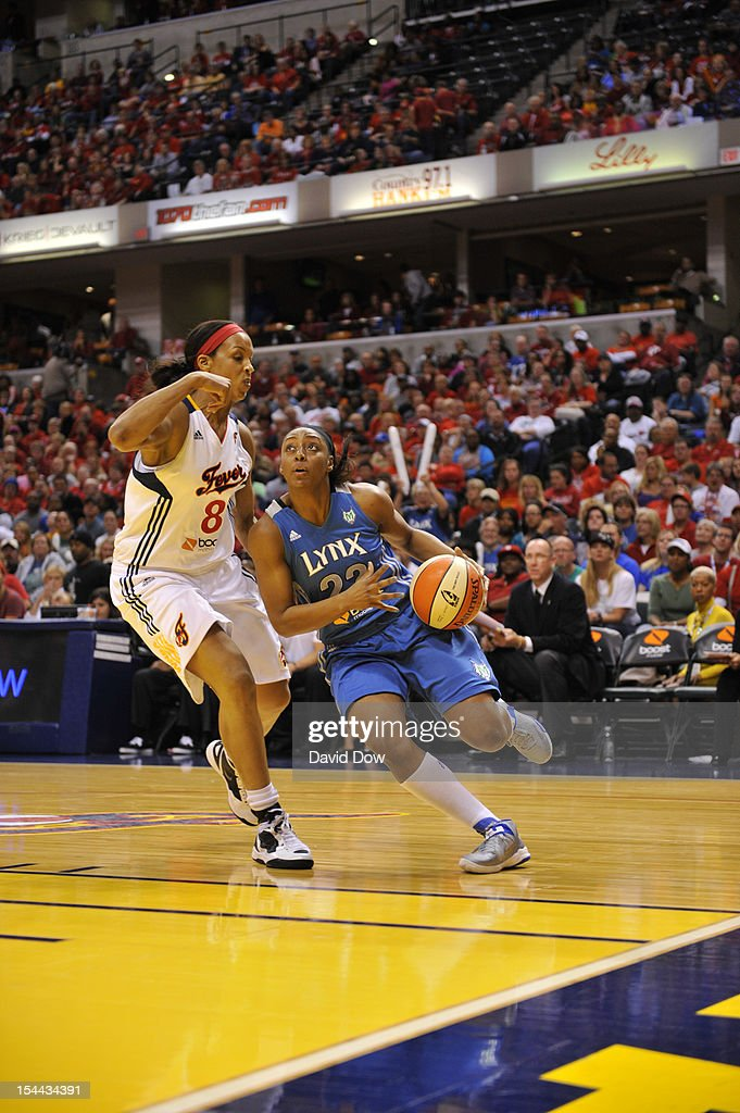 Monica Wright #22 of the Minnesota Lynx drives against <a gi-track='captionPersonalityLinkClicked' href=/galleries/search?phrase=Tammy+Sutton-Brown&family=editorial&specificpeople=208212 ng-click='$event.stopPropagation()'>Tammy Sutton-Brown</a> #8 of the Indiana Fever during Game three of the 2012 WNBA Finals on October 19, 2012 at Bankers Life Fieldhouse in Indianapolis, Indiana.