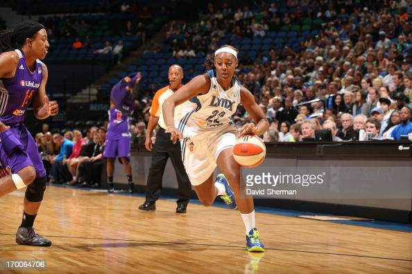 Monica Wright of the Minnesota Lynx drives to the basket past Alexis Hornbuckle of the the Phoenix Mercury during the WNBA game on June 6 2013 at...