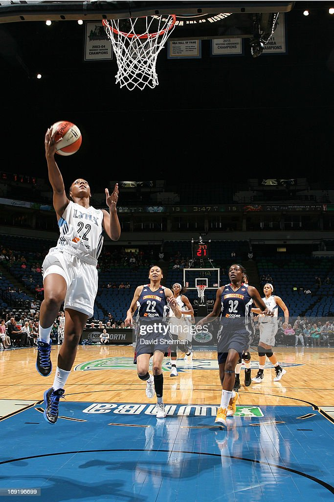Monica Wright #22 of the Minnesota Lynx goes for a layup against Kara Lawson #20 of the Connecticut Sun during the WNBA pre-season game on May 21, 2013 at Target Center in Minneapolis, Minnesota.