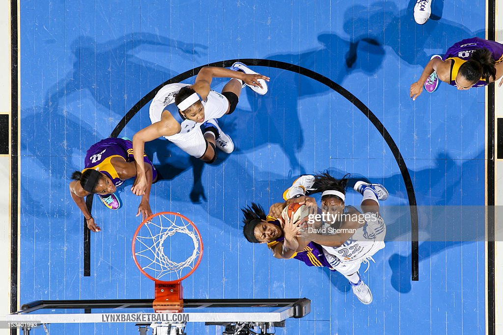 Monica Wright #22 of the Minnesota Lynx goes for a rebound against <a gi-track='captionPersonalityLinkClicked' href=/galleries/search?phrase=Candace+Parker&family=editorial&specificpeople=752955 ng-click='$event.stopPropagation()'>Candace Parker</a> #3 of the Los Angeles Sparks during Game One of the 2012 WNBA Western Conference Finals on October 4, 2012 at Target Center in Minneapolis, Minnesota.
