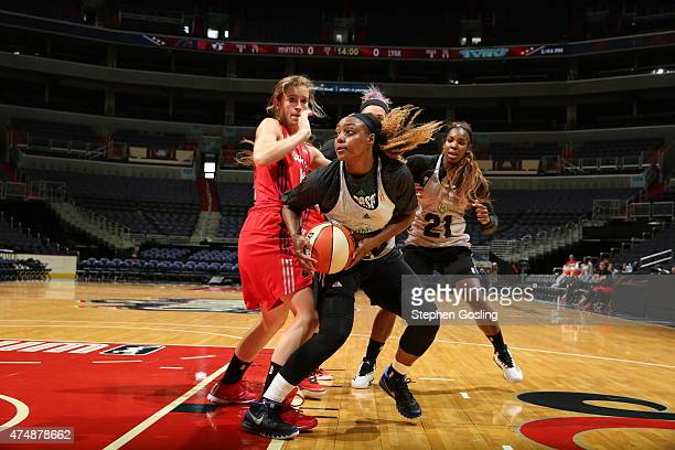 Monica Wright of the Minnesota Lynx handles the ball against the Washington Mystics during an Analytic Scrimmage at the Verizon Center on May 26 2015...