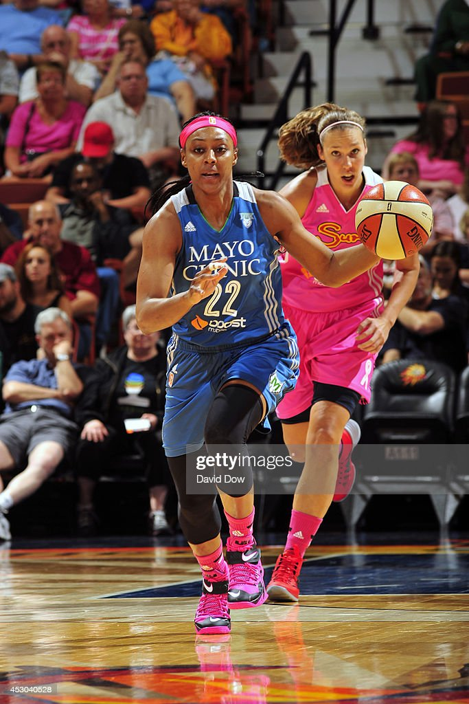 Monica Wright #22 of the Minnesota Lynx moves the ball up-court against the Connecticut Sun on July 27, 2014 at the Mohegan Sun Arena in Uncasville, Connecticut.