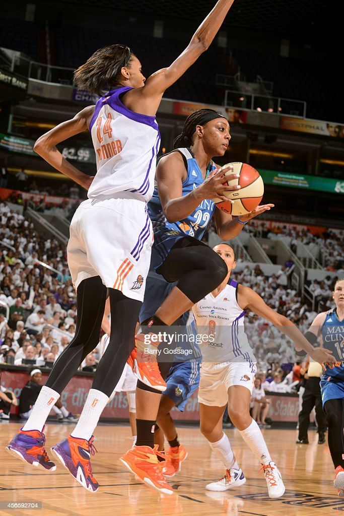 Monica Wright #22 of the Minnesota Lynx passes the ball against the Phoenix Mercury in Game 1 of the 2014 WNBA Western Conference Finals on August 29, 2014 at US Airways Center in Phoenix, Arizona.