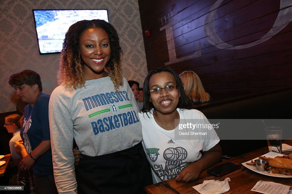 <a gi-track='captionPersonalityLinkClicked' href=/galleries/search?phrase=Monica+Wright+-+Basketball+Player&family=editorial&specificpeople=5756413 ng-click='$event.stopPropagation()'>Monica Wright</a> #22 of the Minnesota Lynx poses with a fan during the Tip-A-Lynx fundraiser to benefit the Minnesota Lynx Fastbreak Foundation on June 3, 2015 at the Loop West End Bar & Restaurant in Minneapolis, Minnesota.