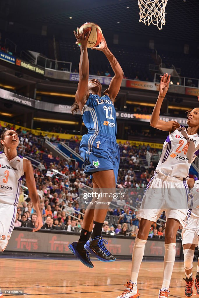 Monica Wright #22 of the Minnesota Lynx shoots against <a gi-track='captionPersonalityLinkClicked' href=/galleries/search?phrase=DeWanna+Bonner&family=editorial&specificpeople=4085058 ng-click='$event.stopPropagation()'>DeWanna Bonner</a> #24 of the Phoenix Mercury on July 21, 2013 at U.S. Airways Center in Phoenix, Arizona.
