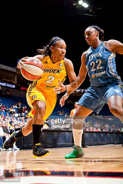 Monica Wright of the Minnesota Lynx tries to stop a drive by Temeka Johnson of the Tulsa Shock during the WNBA game on June 9 2012 at the BOK Center...