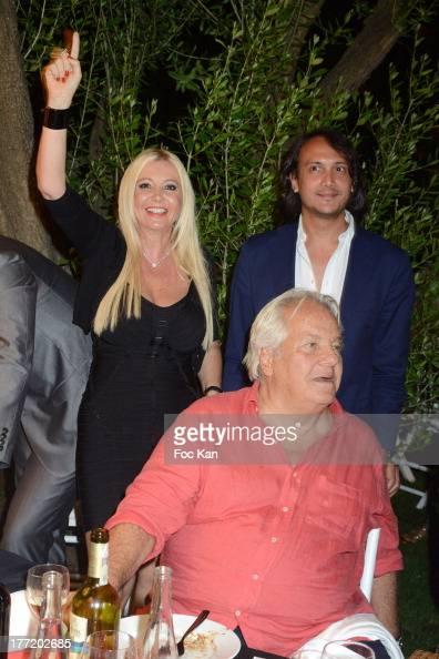 Monika Bacardi and David Kane pose behind Massimo Gargia at the Massimo Gargia's Birthday Dinner at Moulins de Ramatuelle on August 21 2013 in Saint...