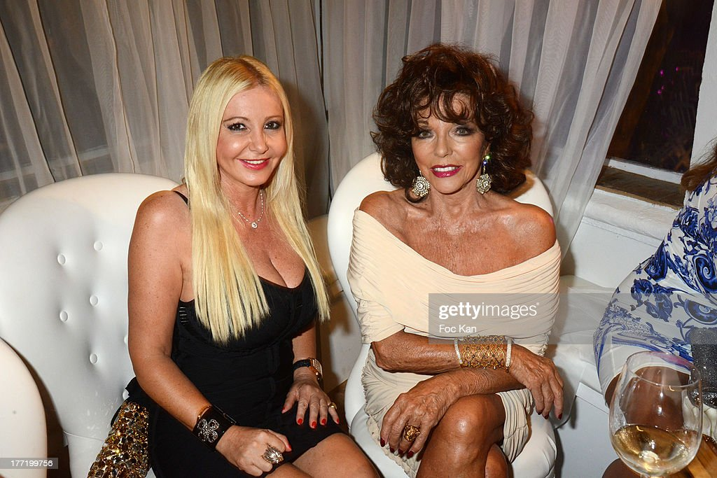 Monika Bacardi and Joan Collins attend the Massimo Gargia's Birthday Dinner at Moulins de Ramatuelle on August 21, 2013 in Saint Tropez, France.