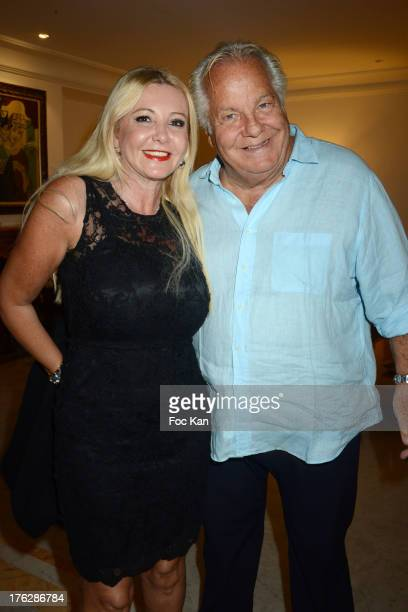 Monika Bacardi and Massimo Gargia attend the Massimo Gargia's Party hosted by Richard Roizen at Villa Les Acanthes In SaintTropez on August 11 2013...