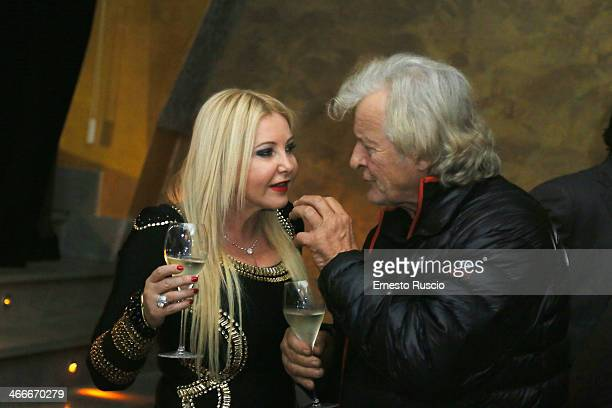 Monika Bacardi and Rutger Hauer attend the 'Sights Of Death' Pre Berlinale Party at NUR BAR on February 2 2014 in Rome Italy