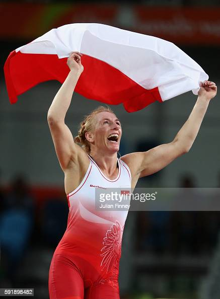 Monika Ewa Michalik of Poland celebrates after defeating Inna Trazhukova of Russia during the Women's Freestyle 63 kg Bronze medal match on Day 13 of...