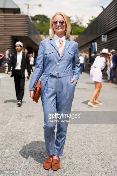 Monika Kaminska wearing bespoke tailoring by Monika Kaminska sirensuit chalkstripe pattern fabric Huddersfield Fine Worsteds wool linen shirt is seen...