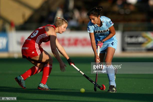 Monika of India and Sophie Bray of England battle for possession during the Quarter Final match between England and India during the FIH Hockey World...
