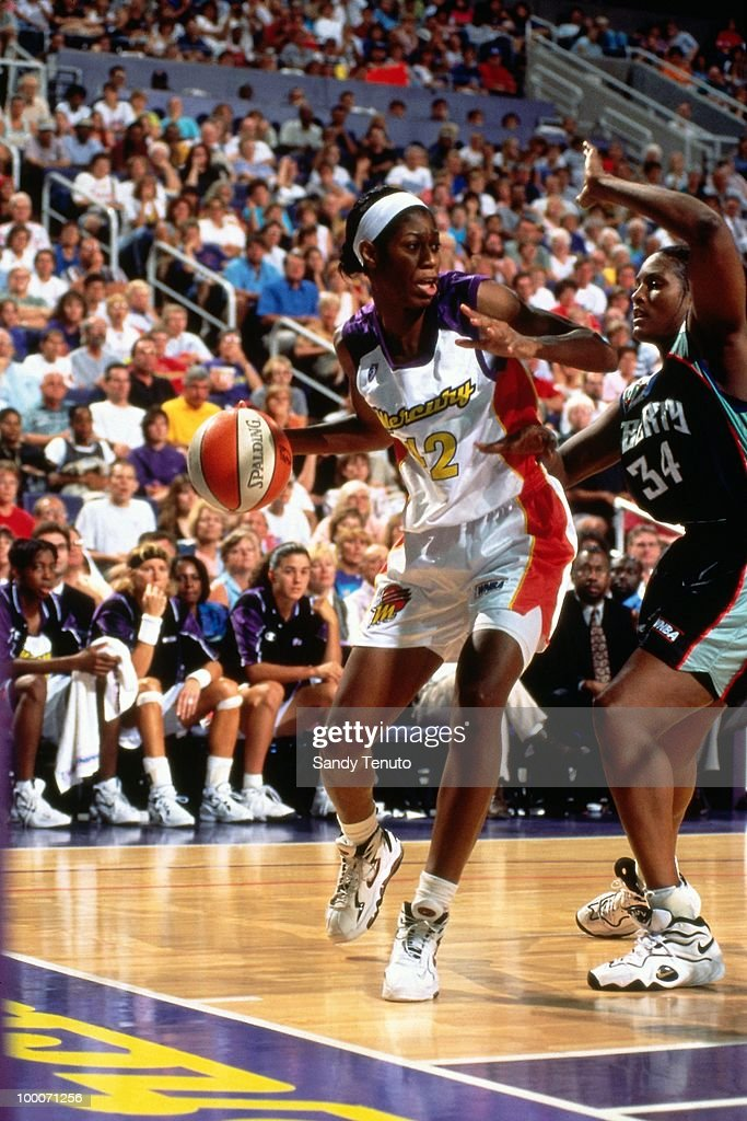 Monique Ambers #42 of the Phoenix Mercury looks to make a move against the New York Liberty during a game played circa 1997 at the America West Arena in Phoenix, Arizona.