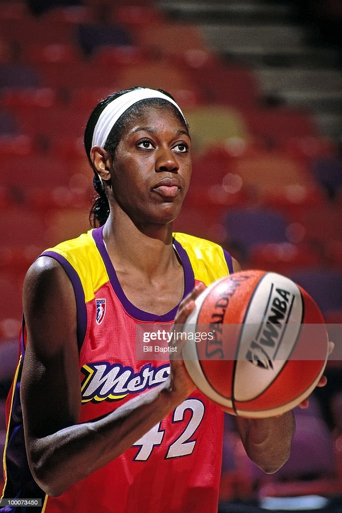 Monique Ambers #42 of the Phoenix Mercury shoots during a game circa 1997 at the America West Arena in Phoenix, Arizona.