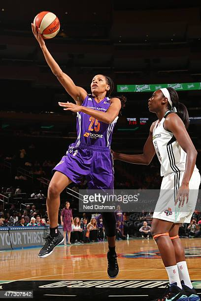 Monique Currie of the Phoenix Mercury drives to the basket against the New York Liberty during a WNBA game on June 11 2015 at Madison Square Garden...