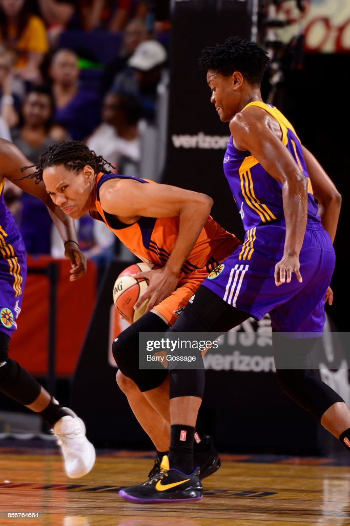 Monique Currie #25 of the Phoenix Mercury handles the ball against Alana Beard #0 of the Los Angeles Sparks in Game Three of the Semifinals during the 2017 WNBA Playoffs on September 17, 2017 at Talking Stick Resort Arena in Phoenix, Arizona.