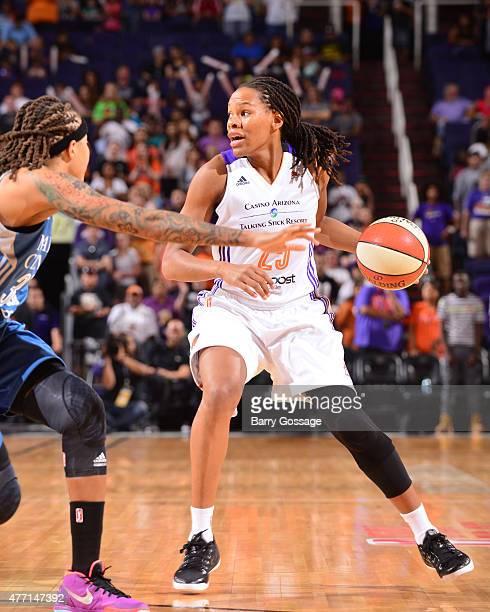 Monique Currie of the Phoenix Mercury handles the ball against the Minnesota Lynx on June 14 2015 at Talking Stick Resort Arena in Phoenix Arizona...