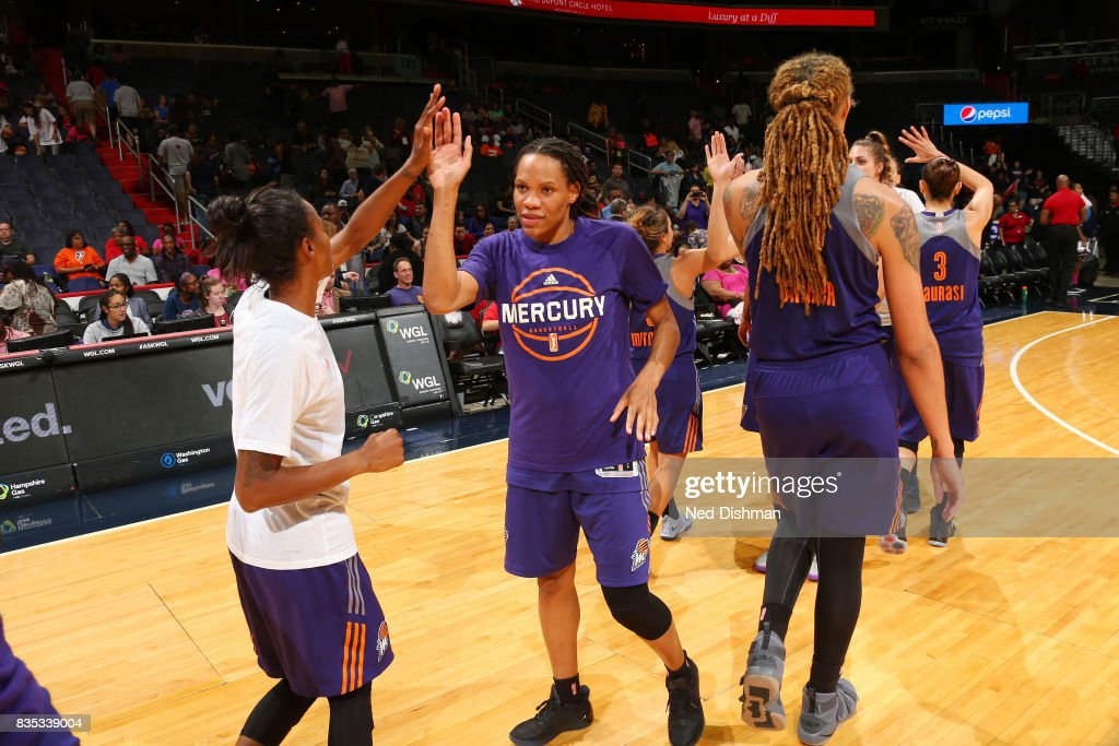 Monique Currie #25 of the Phoenix Mercury shakes hands with teammates after defeating the Washington Mystics on August 18, 2017 at the Verizon Center in Washington, DC.