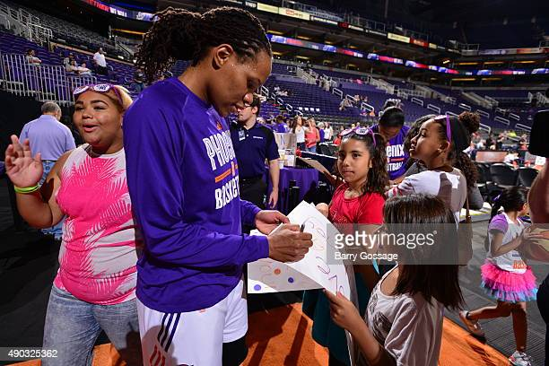 Monique Currie of the Phoenix Mercury signs autographs before the game against the Minnesota Lynx during the WNBA Playoffs Western Conference Finals...