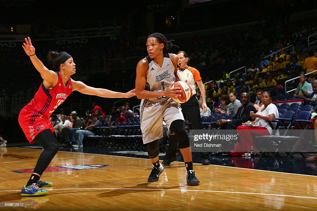 Monique Currie #1 of the San Antonio Stars handles the ball against Natasha Cloud #15 of the Washington Mystics on June 29, 2016 at the Verizon Center in Washington, DC.