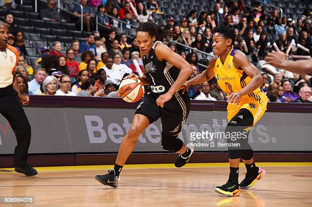 Monique Currie of the San Antonio Stars handles the ball against Alana Beard of the Los Angeles Sparks on September 16 2016 at STAPLES Center in Los...