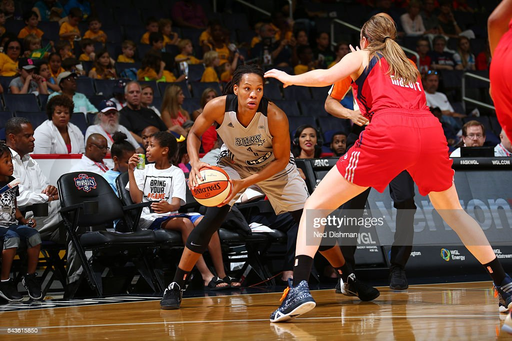 <a gi-track='captionPersonalityLinkClicked' href=/galleries/search?phrase=Monique+Currie&family=editorial&specificpeople=553598 ng-click='$event.stopPropagation()'>Monique Currie</a> #1 of the San Antonio Stars handles the ball against the Washington Mystics on June 29, 2016 at the Verizon Center in Washington, DC.