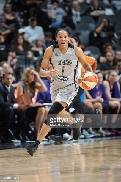 Monique Currie of the San Antonio Stars handles the ball during a game against the Phoenix Mercury on May 19 2017 at ATT Center in San Antonio Texas...