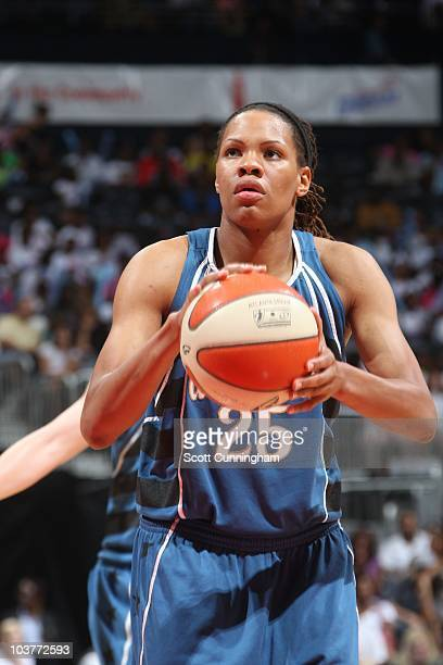 Monique Currie of the Washington Mystics aims for the basket against the Atlanta Dream at Philips Arena on August 22 2010 in Atlanta Georgia The...