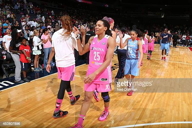 Monique Currie of the Washington Mystics celebrates against the Atlanta Dream at the Verizon Center on July 27 2014 in Washington DC NOTE TO USER...