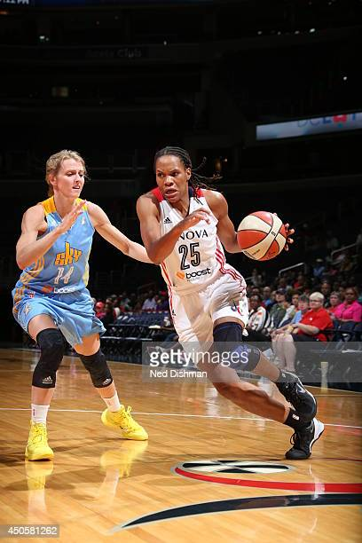 Monique Currie of the Washington Mystics drives against Allie Quigley of the Chicago Sky at the Verizon Center on June 13 2014 in Washington DC NOTE...