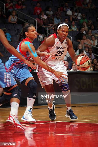 Monique Currie of the Washington Mystics drives against Armintie Price of the Atlanta Dream at the Verizon Center on August 24 2012 in Washington DC...