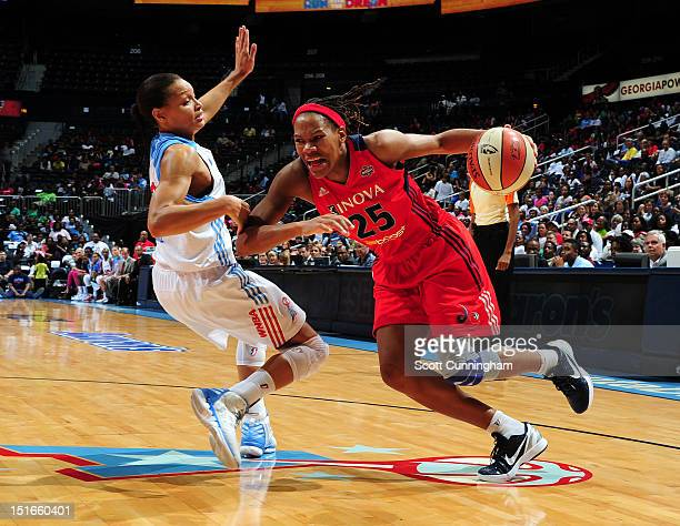 Monique Currie of the Washington Mystics drives against Armintie Price of the Atlanta Dream at Philips Arena on September 9 2012 in Atlanta Georgia...