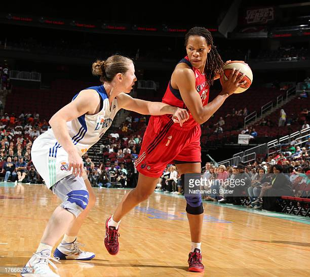 Monique Currie of the Washington Mystics drives against Katie Smith of the New York Liberty during a game on August 16 2013 at the Prudential Center...