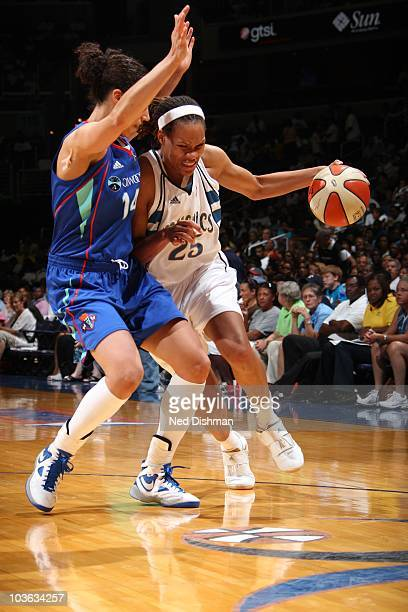 Monique Currie of the Washington Mystics drives against Nicole Powell of the New York Liberty at the Verizon Center on August 20 2010 in Washington...