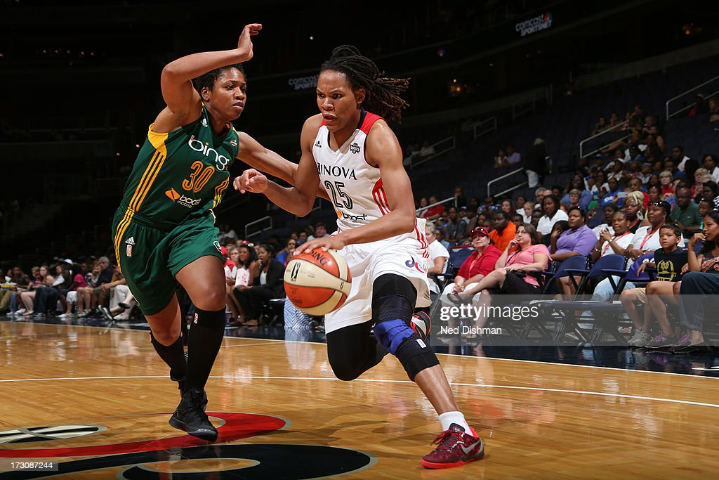 <a gi-track='captionPersonalityLinkClicked' href=/galleries/search?phrase=Monique+Currie&family=editorial&specificpeople=553598 ng-click='$event.stopPropagation()'>Monique Currie</a> #25 of the Washington Mystics drives against <a gi-track='captionPersonalityLinkClicked' href=/galleries/search?phrase=Tanisha+Wright&family=editorial&specificpeople=541423 ng-click='$event.stopPropagation()'>Tanisha Wright</a> #30 of the Seattle Storm at the Verizon Center on July 6, 2012 in Washington, DC.