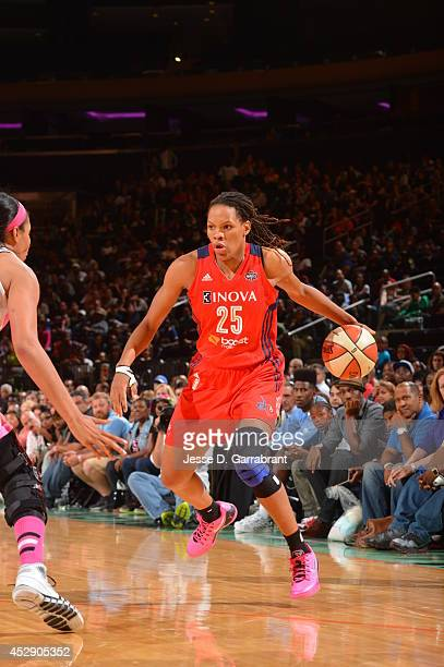 Monique Currie of the Washington Mystics drives against the New York Liberty during the game on July 29 2014 at Madison Square Garden in New York New...