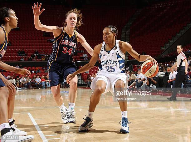 Monique Currie of the Washington Mystics drives the ball against Christina Wirth of the Indiana Fever during Game One of the WNBA Eastern Conference...