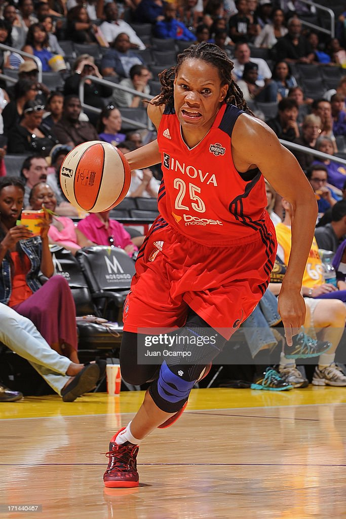 <a gi-track='captionPersonalityLinkClicked' href=/galleries/search?phrase=Monique+Currie&family=editorial&specificpeople=553598 ng-click='$event.stopPropagation()'>Monique Currie</a> #25 of the Washington Mystics drives to the basket against the Los Angeles Sparks at Staples Center on June 23, 2013 in Los Angeles, California.