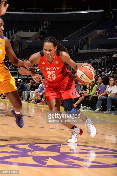 Monique Currie of the Washington Mystics drives to the basket against the Los Angeles Sparks at STAPLES Center on July 17 2014 in Los Angeles...