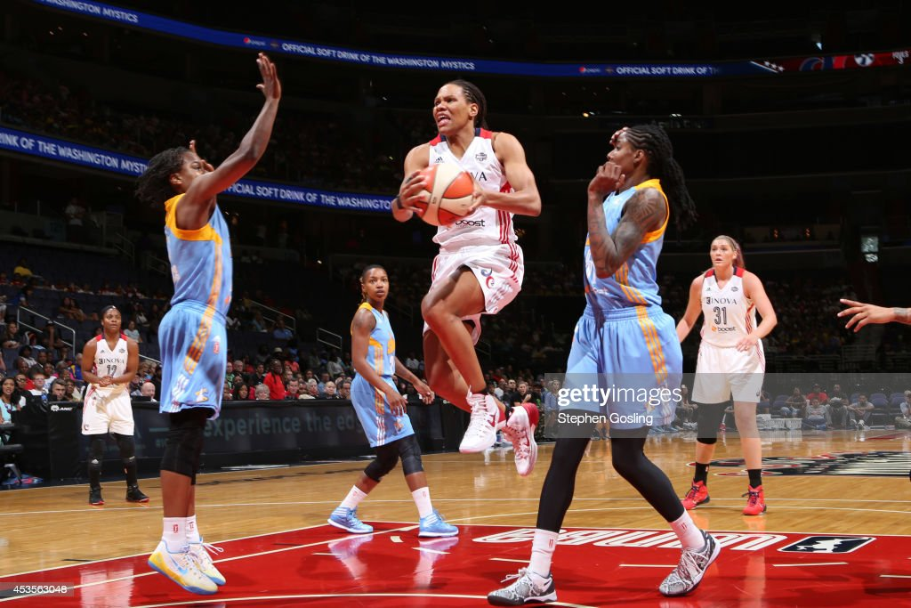 Monique Currie #25 of the Washington Mystics drives to the basket against Jessica Breland #51 of the Chicago Sky at the Verizon Center on August 13, 2014 in Washington, DC.