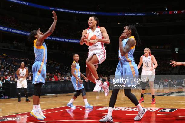 Monique Currie of the Washington Mystics drives to the basket against Jessica Breland of the Chicago Sky at the Verizon Center on August 13 2014 in...