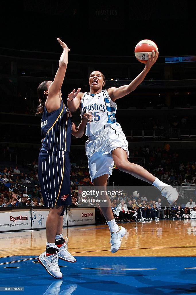<a gi-track='captionPersonalityLinkClicked' href=/galleries/search?phrase=Monique+Currie&family=editorial&specificpeople=553598 ng-click='$event.stopPropagation()'>Monique Currie</a> #25 of the Washington Mystics goes to the basket under pressure against <a gi-track='captionPersonalityLinkClicked' href=/galleries/search?phrase=Tammy+Sutton-Brown&family=editorial&specificpeople=208212 ng-click='$event.stopPropagation()'>Tammy Sutton-Brown</a> #8 of the Indiana Fever during the WNBA game at the Verizon Center on July 24, 2010 in Washington, DC. The Fever won 78-73.