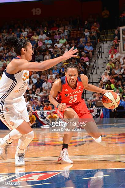 Monique Currie of the Washington Mystics handles the ball against Alyssa Thomas of the Connecticut Sun during the game on August 10 2014 at the...