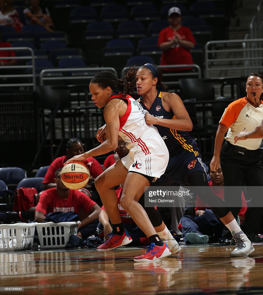 <a gi-track='captionPersonalityLinkClicked' href=/galleries/search?phrase=Monique+Currie&family=editorial&specificpeople=553598 ng-click='$event.stopPropagation()'>Monique Currie</a> #25 of the Washington Mystics handles the ball against Marissa Coleman#25 of the Indiana Fever in Game Two of the Eastern Conference Semifinals during the 2014 WNBA Playoffs on August 23, 2014 at the Verizon Center in Washington, DC.